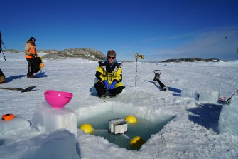 "A tide gauge is deployed in an ice hole at Casey research station, the site of an Antarctic ""heatwave"" earlier this year."