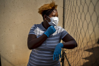Mabatho Mphuthi is one of the very few people wearing a mask in response to the COVID-19 virus outbreak in the Diepsloot township north of Johannesburg, South Africa, on Saturday.