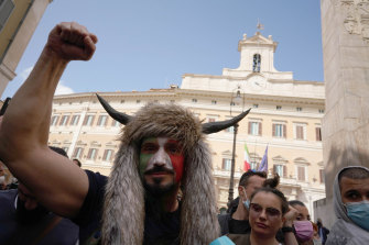 Demonstrators gathered outsideparliament during a protest in Rome on Tuesday.