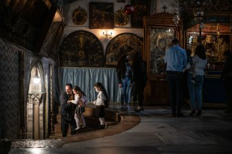 Palestinian Christians celebrate Easter at the Church of the Nativity in Bethlehem, West Bank.
