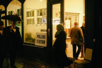 Wet, dark, and dutybound. Locals vote in London's Marchmont Community Centre in WC1.