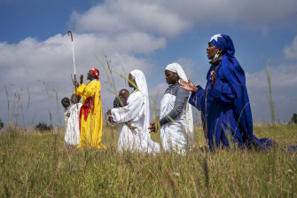 A handful of Pentecostals celebrate Easter in a field in Soweto, Johannesburg, April 4, 2021.