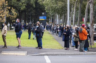 People wait for their allocated time slot earlier this month at the NSW vaccination hub in Homebush.