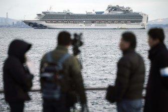 The Diamond Princess cruise ship is anchored off Yokohama port.