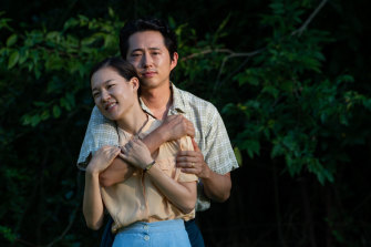 Yeri Han and Steven Yeun in Minari.