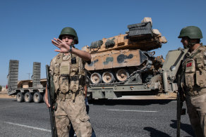 Offensive rolls on. Turkish military vehicles carry tanks to the Syrian border  at the weekend.