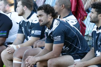 Waiting game: Karmichael Hunt sits out the first half on the bench for Souths.