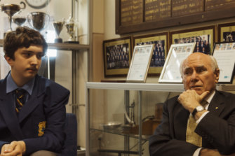 Former prime minister John Howard chats with present-day  Canterbury Boys student, Alexander Lorenzon, during a visit to his old school.