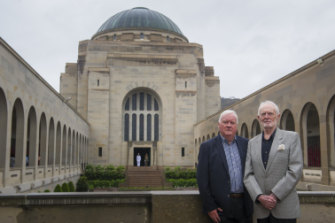 Former deputy director of the Australian War Memorial, Michael McKernan with former director of the Australian War Memorial, Brendon Kelson, 25 years since the Unknown Solider was interred in the Hall of Memory behind them.