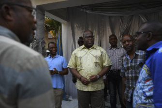 Leader of the Union for Democracy and Social Progress Party and Presidential candidate Felix Tshisekedi (centre) greets staff and supporters at his office in the capital, Kinshasa.