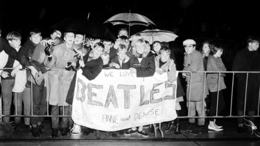 Young fans await the arrival of The Beatles at Mascot Airport, Sydney, on 18 June 1964.