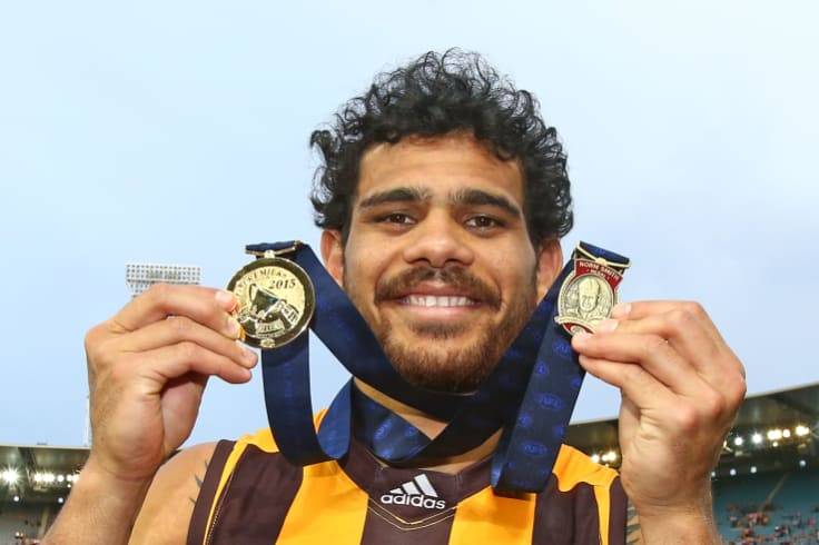 Big-game player: Cyril Rioli with his 2015 premiership medallion and Norm Smith Medal.