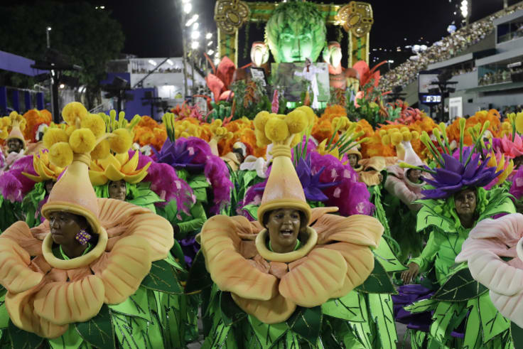 Performers from the Sao Clemente samba school parade during Carnival celebrations at the Sambadrome in Rio de Janeiro.