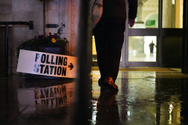 Wet. Dark. Sombre. Islington Town Hall Polling Station in  London.