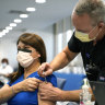 A nurse receives a Pfizer COVID-19 booster shot at a hospital in Miami this month.