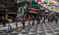 People line up for COVID-19 tests this week on Khaosan Road in Bangkok.