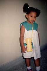 Yassmin, here aged three, loved  wearing dresses as a child.