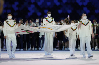 Australian Elena Galiabovitch (right) carries the Olympic flag into the stadium.