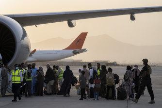 Passengers board a Qatar Airways plane at Kabul airport on Thursday.