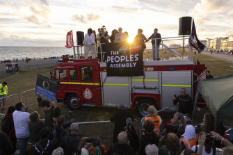 Former Labour leader Jeremy Corbyn speaks from the top of a fire engine parked outside the conference.