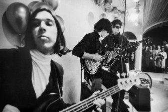 John Cale and fellow band members in a scene from The Velvet Underground.
