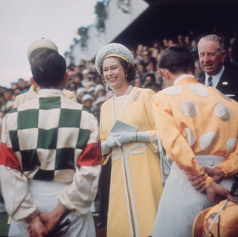 """Speaking a cultivated """"Queen's English"""" was once seen as terribly important by some but Queen Elizabeth herself looks unfussed during a visit to Randwick racecourse in 1970."""