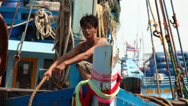 A fisherman arriving in port in Pattani, Thailand.