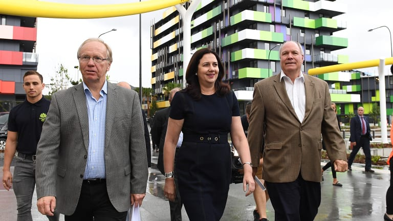 Commonwealth Games chairman Peter Beattie, Premier Annastacia Palaszczuk and Games chief executive Mark Peters inspect progress at the Games Village at Southport.