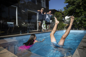 Trudi and Rohan Ritchie watch their kids Zali and Broc swim in their new plunge pool.