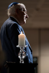 Eddie Jaku with the lit candle at the 75th anniversary of liberation of Auschwitz in Sydney