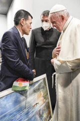 Pope Francis speaks to Abdullah Kurdi, left, father of Alan Kurdi, a the-year-old Syrian boy who drowned at the height of the 2018 migrant crisis.