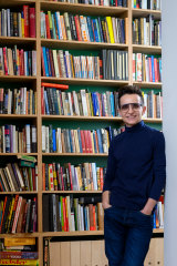 Masha Gessen at home: book shelves stretch to the ceilings.