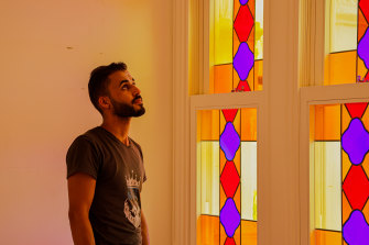 Sursock Museum employee Malek Al Steyfll inspects the building's newly replaced stained glass windows.