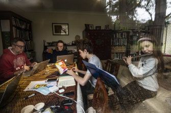 David Gamble and Jennifer Crawford with their two children, Imogen, 10, and Rory, 14, working and learning at home in Balmain.