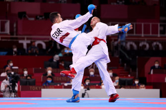 Steven Da Costa, right, of France competes against Hamoon Derafshipour of the IOC Refugee Team during the men's karate kumite -67kg elimination round on Thursday.