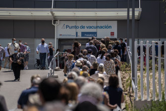 Hundreds of people queue in July to be vaccinated against COVID-19 at the Enfermera Isabel Zendal Hospital in Madrid, Spain.