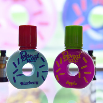 Blueberry and apple-flavoured e-liquids on show at a trade show in London in April.