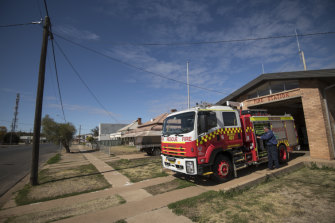 Rod Barclay tends to a NSW Fire & Rescue tanker at Warren's fire station.