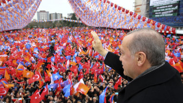 Turkey's President Recep Tayyip Erdogan waves as he addresses his supporters during a rally in Kocaeli, Turkey, on Saturday.