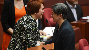 Kitching celebrates her maiden Senate speech with Penny Wong.