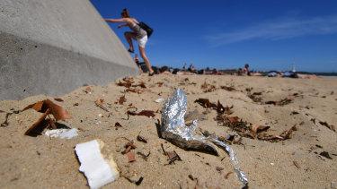 Rubbish on the sand at St Kilda beach.