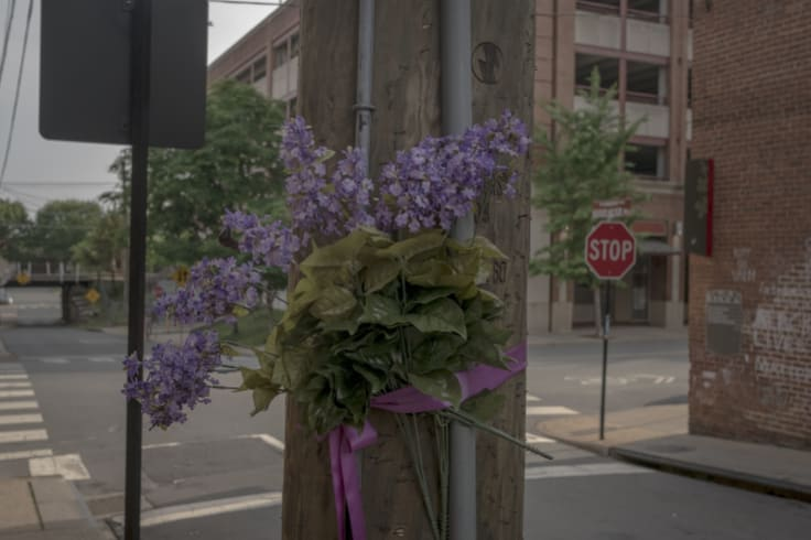 Flowers mark the site where Heather Heyer was killed last year in Charlottesville.