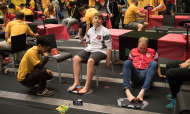 Toeing the line: Competitors solve Rubik's Cube with their feet at the Speedcubing World Championship in Melbourne.