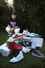 Sneaker enthusiast Jerome Salele'a at home in Belmore with some of his shoe collection.