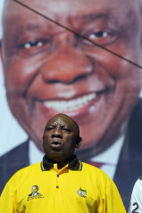 South African President Cyril Ramaphosa sings the national anthem at Sunday's rally.