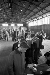 National Service recruits arrive at the Marrickville Army Depot in Sydney, 30 June 1965. T
