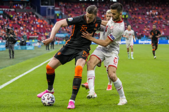 Wout Weghorst of the Netherlands, left, duels for the ball with North Macedonia's Visar Musliu.