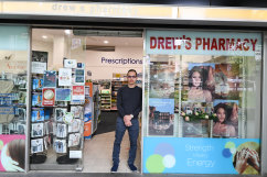 Pharmacist Michel Nguyen outside Drews Pharmacy in Miller Street, North Sydney.