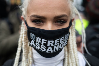 A protester outside Belmarsh Prison in London on Monday.