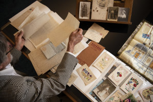 Idris Pike examines personal letters written by his grandfather Idris Charles Pike to his girlfriend Violet Clapson, from 1915-1919 during the Gallipoli campaign.